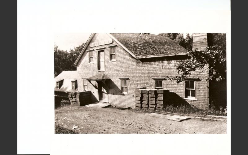 At one time a shingle mill was also attached to the grist mill. This is likely the small addition to the left of the main building. Date of photo is unknown.