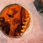 Edge of the spur wheel seen from above through the bed stone hole.