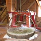 Runner stone lifted off the bed stone by the mill crane.